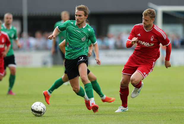 FOOTBALL: Anders Holst (FC Helsing¿r) is closed down by Matt Mills (Nottingham Forest) during the pre-season match between FC Helsing¿r and Nottingham Forest at Helsing¿r Stadion on July 14, 2015 in Helsing¿r, Denmark. Photo: Claus Birch / ClausBirch.dk